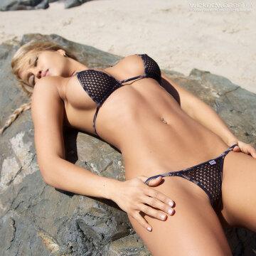 tiny bikinis looks amazing on a fit girl