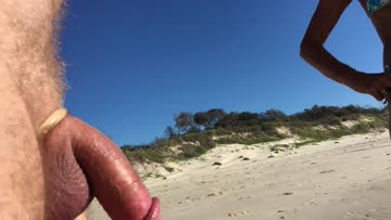 amateur public erection masturbation cfnm exhibitionist on beach. mature watches the stroking, amateur young jogger smiles and waves.