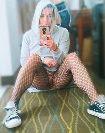 sweatshirt dress, fishnets and chucks