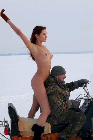 getting a snowmobile ride