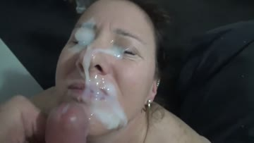 amateur milf sucks a cock and gets her face covered in cum