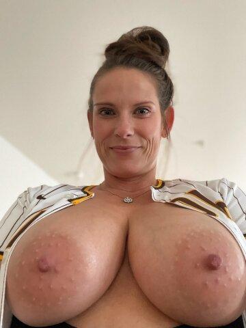 showing her super big tits