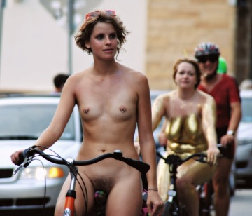 showing off nipple rings at a naked bike ride